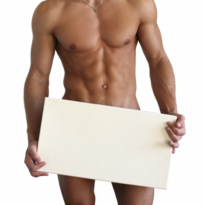 Naked muscular torso covering with a copy space box isolated on white