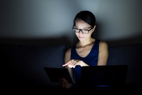 Asian woman use notebook computer at home
