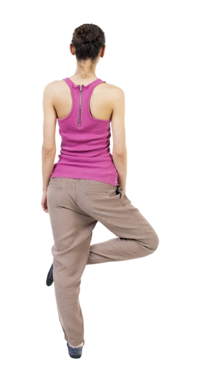 Back view of the girl sitting in front of a warm up exercise. Rear view people collection. backside view of person. Isolated over white background. African-American woman standing on one leg doing yoga.