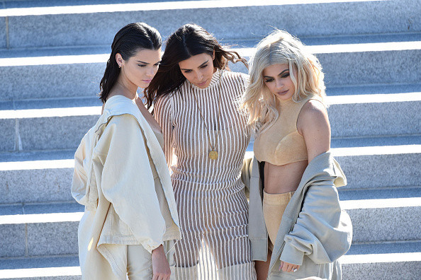 NEW YORK, NY - SEPTEMBER 07: (L-R) Kendall Jenner, Kim Kardashian and Kylie Jenner attend the Kanye West Yeezy Season 4 fashion show on September 7, 2016 in New York City. (Photo by Bryan Bedder/Getty Images for Yeezy Season 4)