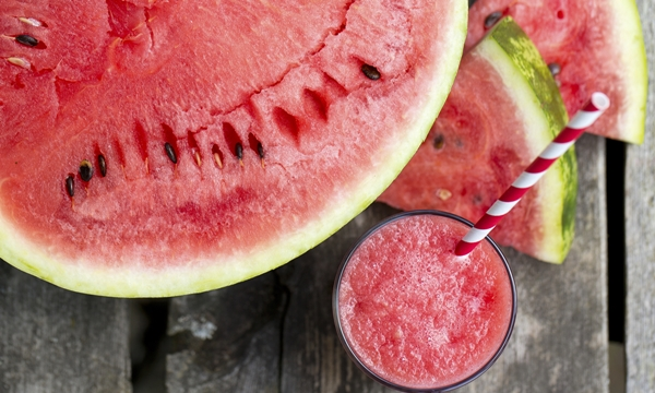 Water melon smoothie on garden table